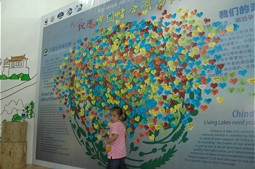 Girl in front of the map with wishes.